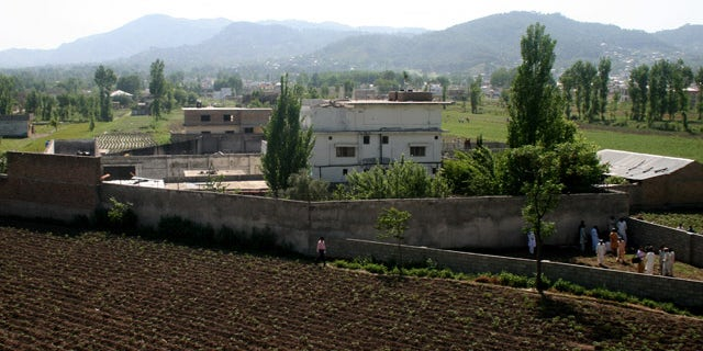 A view of Osama bin Laden's compound in Abbottabad, Pakistan, on Tuesday, May 3, 2011, after a U.S. military raid late Monday which ended with the death of the al-Qaida leader Osama bin Laden and others inside the compound.  U.S. Navy SEALs swept through the massive compound Monday in pursuit of their target, bin Laden, and it is revealed Tuesday by White House counterterrorism adviser John Brennan that the U.S. already was scouring through items seized in the raid, said to include hard drives, DVD's, a pile of documents and other items.  (AP Photo/Aqeel Ahmed)