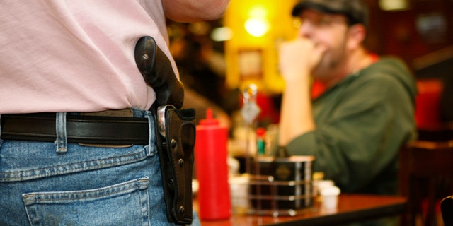 Nov. 1, 2012: A Oklahoma resident wears an unconcealed side arm.