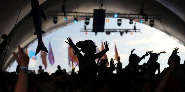 Festival goers dance during the Glastonbury Festival June 28, 2014.