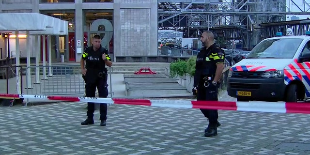 In this image taken from video officers stand behind a cordoned-off area in Rotterdam, Wednesday Aug. 23, 2017, after a concert by an American rock band was cancelled Wednesday night following a threat, the city's mayor said.