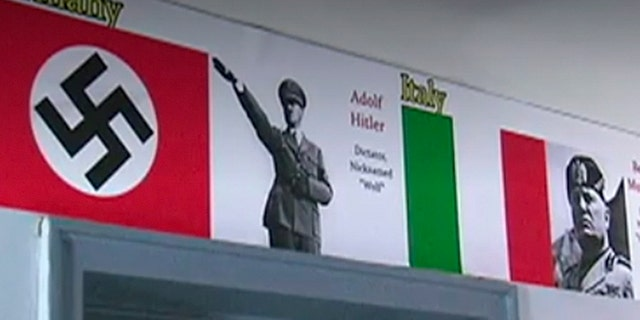 World War II poster showing an image of Hitler inside building in New York City