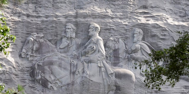 The carving depicts confederates Stonewall Jackson, Robert E. Lee and Jefferson Davis, in Stone Mountain, Ga.