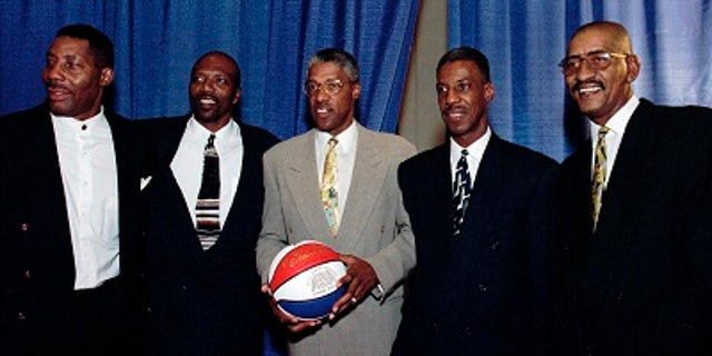 Basketball players from left, Connie Hawkins, Marvin Barnes, Julius Erving, Charlie Scott and George Gervin pose for a photograph at the American Basketball Association 30th Reunion in 1997.