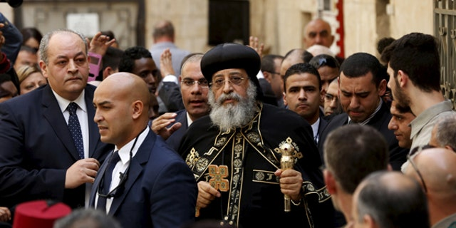 November 28, 2015: Egyptian Coptic Pope Tawadros II (C), head of the Coptic Orthodox church, arrives to the funeral of Anba Abraham, Coptic Archbishop of Jerusalem and the Near East, in Jerusalem's Old City. Tawadros' attendance comes after a decades-old ban on set by his predecessor, the late Pope Shenouda III.
