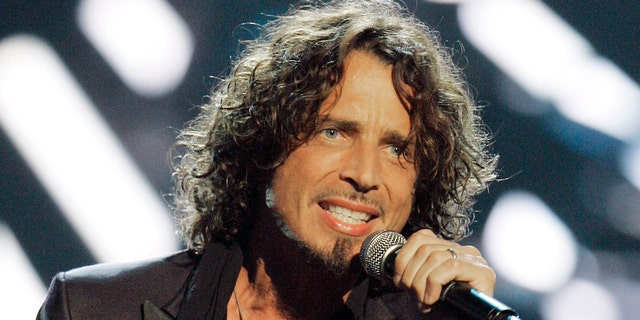 In this Sept. 5, 2008, file photo, musician Chris Cornell performs on stage during Conde Nast's Fashion Rocks show in New York.