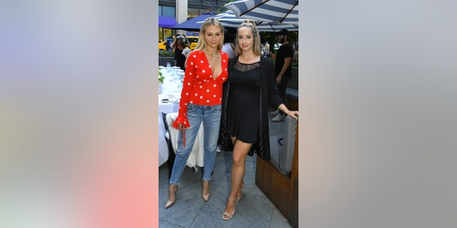 """The former """"Bachelor"""" star dished the show's recent news and revealed her thoughts on Colton Underwood as the new bachelor. Here Olympios poses with fashion designer Morgan Clifford."""