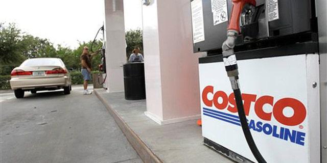 Nov. 8, 2011: Customers pump gasoline at a Costco gas station in Winter Park, Fla.