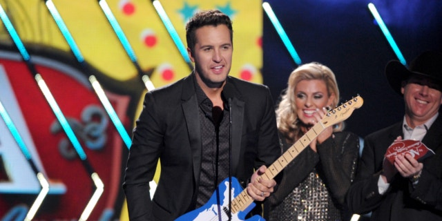 Dec. 10, 2013: Luke Bryan accepts the male artist of the year award onstage at the American Country Awards at the Mandalay Bay Resort & Casino in Las Vegas, Nev.