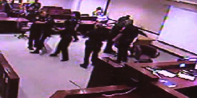 Guilty verdicts in a Florida murder case led to a courtroom melee involving defendants and court security officers that was caught on video.