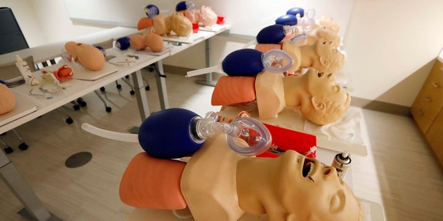 Male mannequins are arranged to train incoming medical students in CPR, in Jackson, Miss., Aug. 4, 2017.