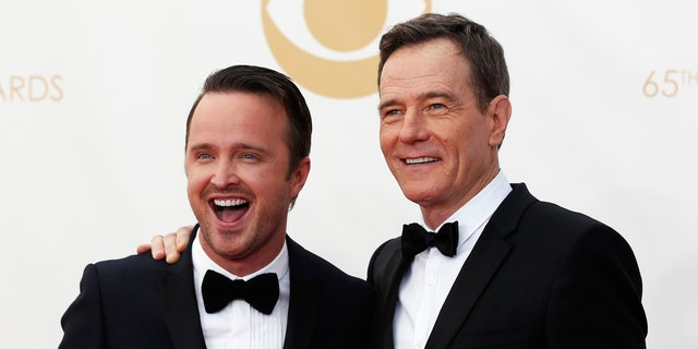 """September 22, 2013. Actors Aaron Paul (L) and Bryan Cranston from """"Breaking Bad""""  arrive at the 65th Primetime Emmy Awards in Los Angeles."""