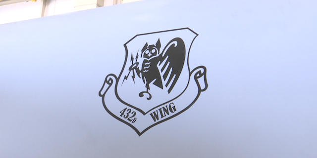 The logo of the 432nd Air Expeditionary Wing is emblazoned on the side of the MQ-9 Reaper