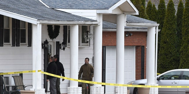 FBI and bomb squad approach a Middletown home as part of their investigation into a car that was crashed into the local hospital.