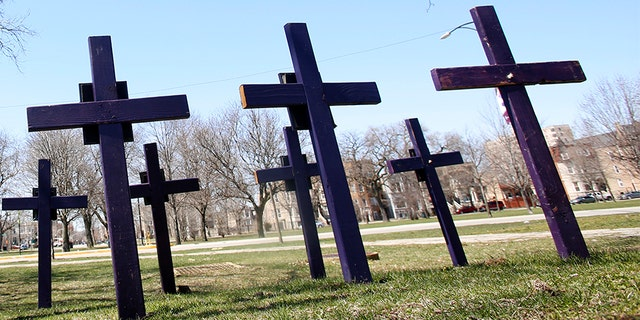April 19, 2018: Crosses representing victims of gun violence stand outside Collins Academy High School in Chicago's North Lawndale neighborhood. With frustration mounting over lawmakers' inaction on gun control, the American Medical Association on Tuesday, June 12, 2018, pressed for a ban on assault weapons and came out against arming teachers as way to fight what it calls a public health crisis.