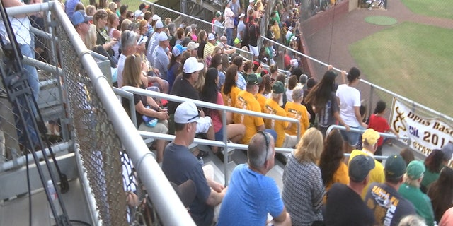 An overflow crowd fills Jim Kethan Field in Deer Park, Texas, for a playoff baseball game featuring Santa Fe High School.