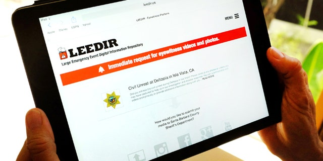 April 24, 2014: A tablet computer displays a web site for LEEDIR, or the Large Emergency Event Digital Information Repository, that aims to make use of a document-everything culture evident on Instagram, Facebook and other social media to benefit law enforcement nationwide.