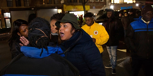April 4, 2018: Sandy Michelin, an aunt of Kimani Gray, who was fatally shot by police in 2013, shouts at officers after police shot and killed a man in the Crown Heights neighborhood of Brooklyn.
