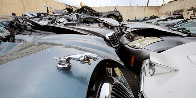 A classic Chevrolet Corvette and Jaguar sedan were among the wrecked cars.