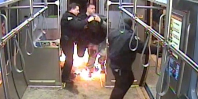 Video of the incident shows Ferguson arguing with an officer before the pair starts fighting, and he sets the train on fire.