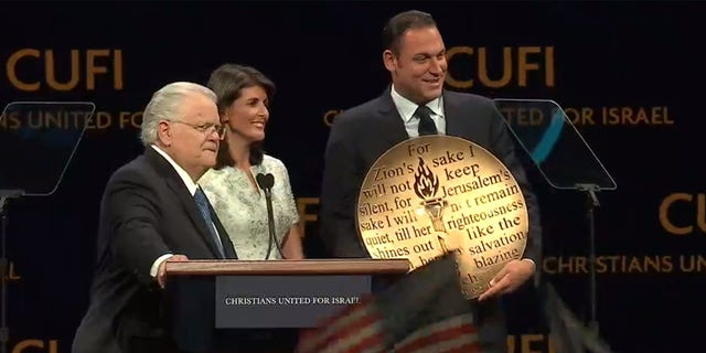 "Pastor John Hagee and Erick Stakelbeck present Nikki Haley with the ""Defender of Israel Award"" at CUFI's largest Night to Honor Israel yet."