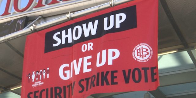 A culinary union banner calling for members to vote to strike hangs over the Thomas & Mack Center at UNLV on May 22nd.