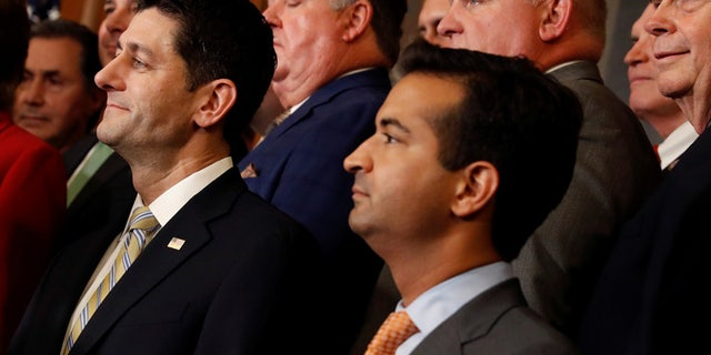 Florida Republican Rep. Carlos Curbelo, center, has concerns about the latest DOJ announcement on pot.