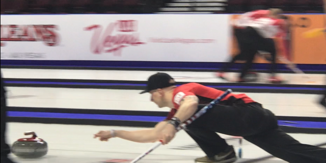 Team USA member, Colin Hufman, throws the rock down the ice at the Men's World Championships in Las Vegas