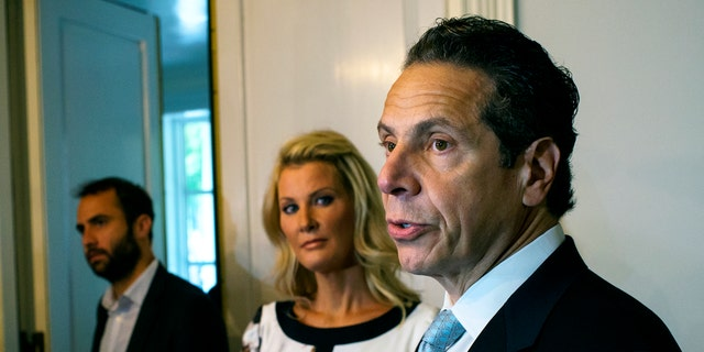 Sept. 9, 2014: Governor Andrew Cuomo, standing with his partner Sandra Lee, center, address members of the media after casting a vote in the primary election.