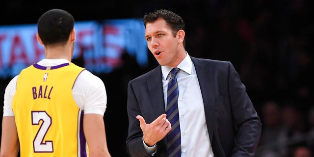 """I'll play for anybody,"" Lakers rookie Lonzo Ball, left, said when asked about his coach, Luke Walton."