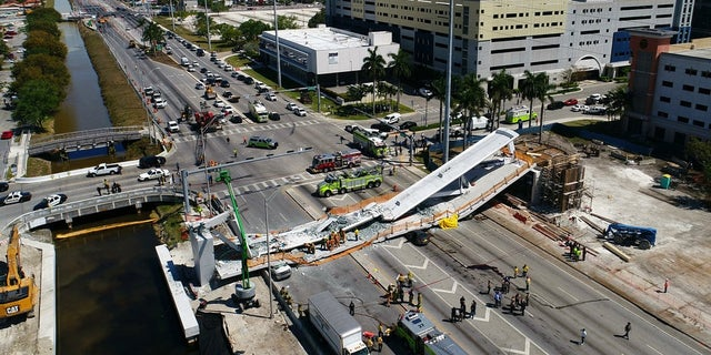 Police and medical personnel respond to the fatal bridge collapse in Florida.