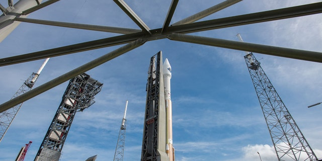 In this photo provided by the United Launch Alliance, an Atlas V rocket carrying the Orbital ATK Cygnus spacecraft, is rolled from the Vertical Integration Facility to a launch pad at the Cape Canaveral Air Force Station in Cape Canaveral, Fla., on Wednesday, Dec. 2, 2015. (United Launch Alliance via AP)