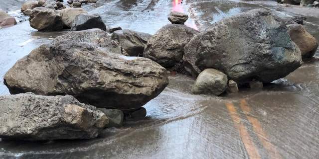 Boulders block a road after a mudslide in Montecito, California, U.S. in this photo provided by the Santa Barbara County Fire Department, January 9, 2018.