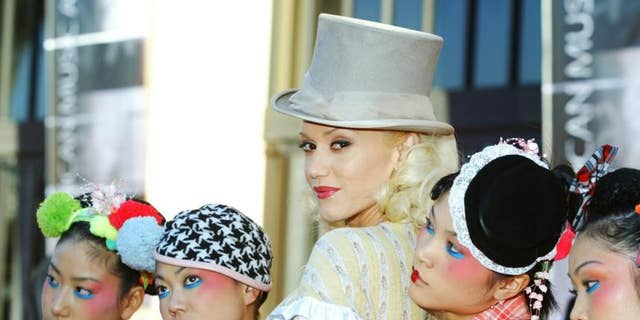 Gwen Stefani poses on the red carpet with the Harajuku Girls at the 32nd annual American Music Awards in Los Angeles on November 14, 2004.
