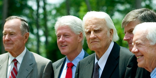 The late Rev. Billy Graham gathers with presidents George H.W. Bush, Bill Clinton and Jimmy Carter.