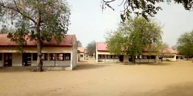 This image taken from video on Thursday Feb. 22, 2018 shows the exterior of Government Girls Science and Technical College in Dapchi, Nigeria.