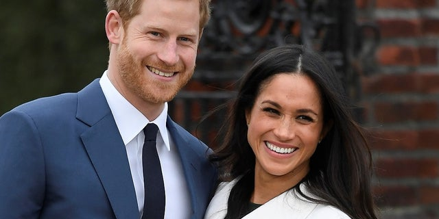 Britain's Prince Harry and his wife Meghan Markle. He is sixth in line to the throne.