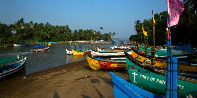 Fishing boats are seen anchored on the bank of a river, in Goa, Friday, Oct. 14, 2016. The leaders of five big developing nations that banded together in 2009 as the so-called BRICS nations, are set to attend their annual summit Oct. 15-16, 2016 in a beach resort town in the western Indian state of Goa. But with their own economies now flagging, some analysts are questioning whether the group, consisting of Brazil, Russia, India, China and South Africa, still has clout in representing nearly half the world's population and a quarter of its economy at $16.6 trillion. (AP Photo/Anupam Nath)