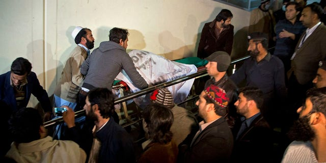 Pakistani volunteers move remains of plane crash victims to a mortuary at a hospital, in Abbottabad, Pakistan, Wednesday, Dec. 7, 2016. Pakistan's national carrier says one of its planes crashed shortly after takeoff from the northern city of Chitral with 48 people aboard. A spokesman for the Interior Ministry said there were no survivors. Rescuers told The Associated Press that the victims' bodies were beyond recognition. (AP Photo/B.K. Bangash)