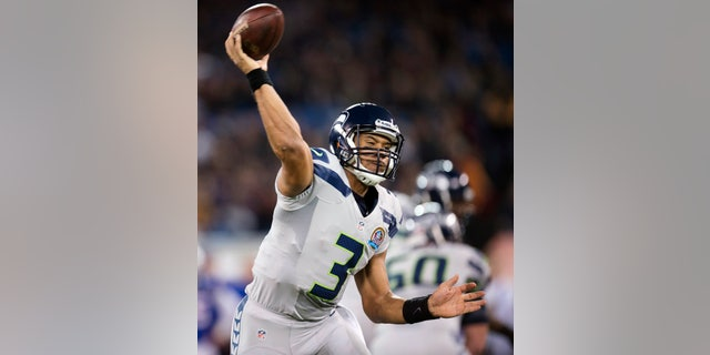 Seattle Seahawks quarterback Russell Wilson throws a pass against the Buffalo Bills during the first half of an NFL football game, Sunday, Dec. 16, 2012, in Toronto. (AP Photo/The Canadian Press, Frank Gunn)