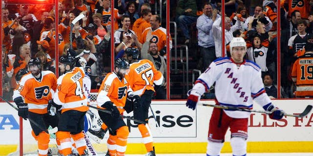 Philadelphia Flyers' Wayne Simmonds, second from right, celebrates his hat trick with teammates during the second period in Game 6 of an NHL hockey first-round playoff series against the New York Rangers, Tuesday, April 29, 2014, in Philadelphia. (AP Photo/Chris Szagola)