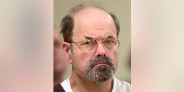 "FILE - In this Oct. 12, 2005, file photo, convicted BTK killer Dennis Rader listens during a court proceeding in El Dorado, Kan. A new book says the BTK serial killer planned to kill an 11th victim by hanging her upside down in her Wichita, Kansas, home. It's a story police heard from Dennis Rader himself in 2005, but decided at the time to suppress to protect the woman. The story was made public in ""Confession of a Serial Killer: The Untold Story of Dennis Rader, the BTK Killer,"" which has a scheduled release date of Sept. 6. (Travis Heying/The Wichita Eagle via AP, Pool)"