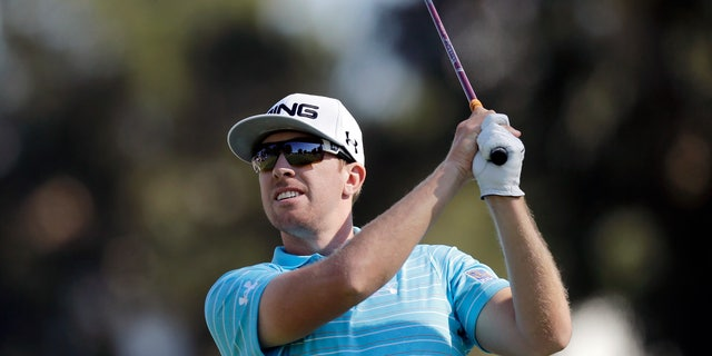 Hunter Mahan drives on the second tee in the final round of the Northern Trust Open golf tournament at Riviera Country Club in the Pacific Palisades area of Los Angeles Sunday, Feb. 17, 2013. (AP Photo/Reed Saxon)