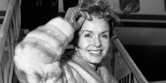 Screen actress Debbie Reynolds is a pretty wind-blown portrait as she boards airliner on March 6, 1959 in New York for Spain where she will film a new picture.