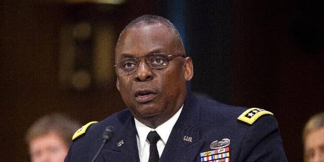 "In this Sept. 16, 2015, photo, U.S. Central Command Commander Gen. Lloyd Austin III, testifies on Capitol Hill in Washington. The Obama administration is preparing a major overhaul of its failed effort to train thousands of moderate Syrian rebels to fight the Islamic State group, shifting from preparing rebels for frontline combat to a plan to embed them with established Kurdish and Arab forces in northeastern Syria, U.S. officials said. The discussion of a new approach comes a day after Austin, told Congress that the $500 million effort to train 5,000 moderate Syrian rebels in a year had yielded ""four or five"" new fighters after another 50 or so were captured, wounded or fled in their first encounter with extremist militants. (AP Photo/Pablo Martinez Monsivais)"