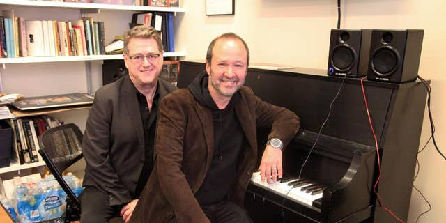 """This April 30, 2015 photo shows playwright Robert L. Freedman, left, and composer Steven Lutvak in New York. The duo co-wrote the Tony Award-winning musical """"A Gentleman's Guide to Love and Murder"""" and are being honored by their alma mater, New York University's Tisch School of the Arts. (AP Photo/Mark Kennedy)"""