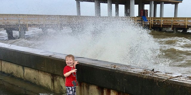 A large wave churned up by Tropical Depression Cindy hits a sea wall at the harbor in Pass Christian, Miss., on Thursday, June 22, 2017.