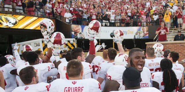 The Indiana football team celebrates in front of fans after Indiana upset Missouri, 31-27, in an NCAA college football game Saturday, Sept. 20, 2014, in Columbia, Mo. (AP Photo/L.G. Patterson)