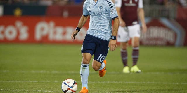 This Aug. 29, 2015 photo shows Sporting KC midfielder Benny Feilhaber (10) in the second half of an MLS soccer match in Commerce City, Colo. Feilhaber is one of several veteran players who thought their U.S. national team careers were over until they got a second shot under new coach Bruce Arena. After a January training camp, the revamped roster begins ramping up for key World Cup qualifiers with an exhibition against Serbia on Sunday in San Diego. (AP Photo/David Zalubowski)