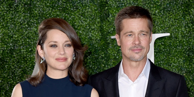 """Marion Cotillard, left, and Brad Pitt arrive at the Los Angeles premiere of """"Allied"""" at the Regency Village Theatre on Wednesday, Nov. 9, 2016."""
