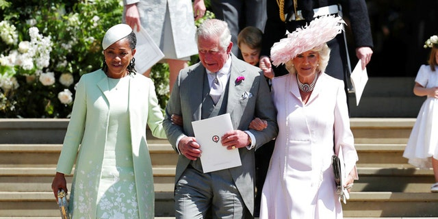 Prince Charles escorts Doria Ragland and Camilla Parker Bowles into the church.